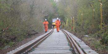 Engineers walk along freshly-laid track near Okehampton, Devon