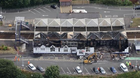 An aerial view showing the extent of fire damage at Troon station